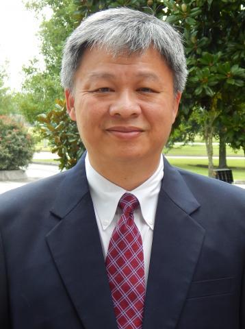 Dr. Chu smiling